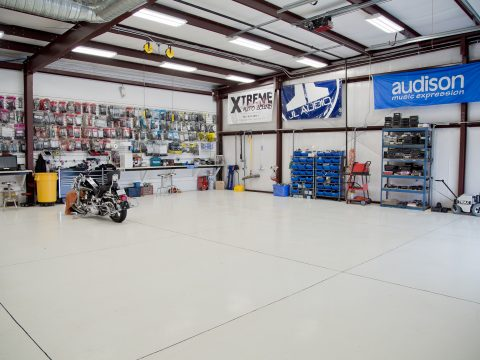 Open shop floor with motorcycle and audio accessories